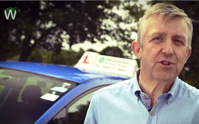 Still of Alastair Greener, presenter of the Wimbledon Driving School video