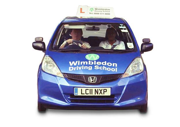 Blue car bearing Wimbledon Driving School branding