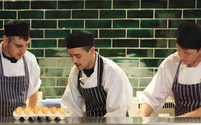 Chefs working in an Oakman Inns kitchen