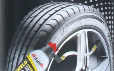Tyre and can detail from front of Holts Tyreweld