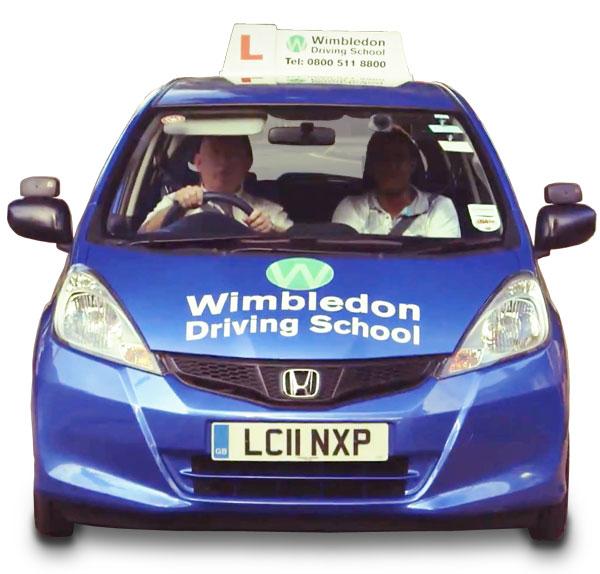 Video presenter scriptwriting: blue car bearing the Wimbledon Driving School logo