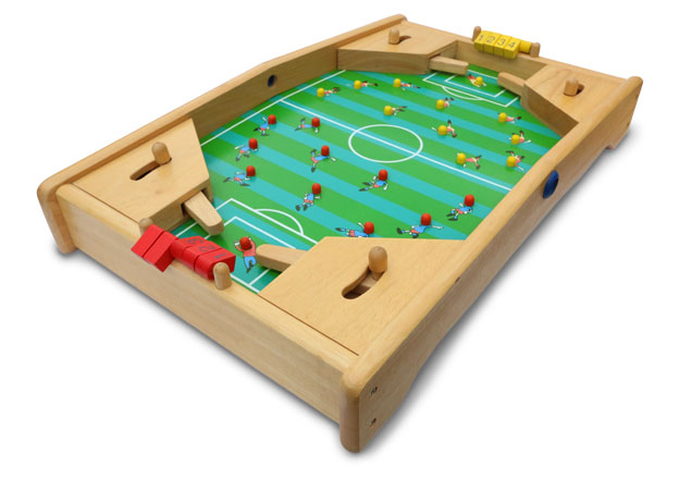 Table-top football game with green striped pitch