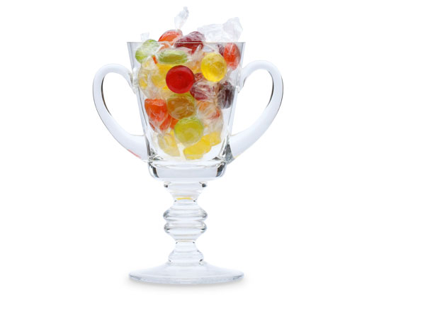 Two-handled glass trophy filled with sweets