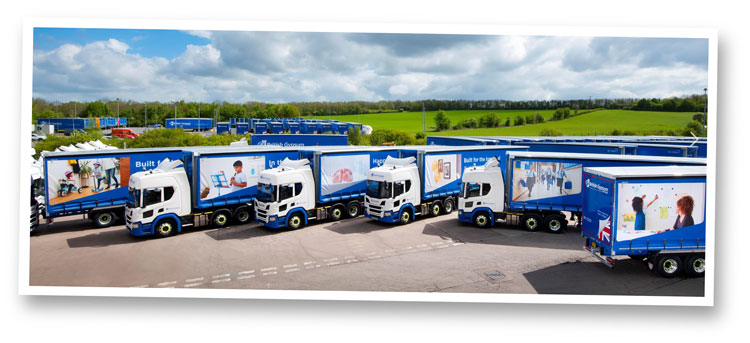 Fleet livery copywriting: six British Gypsum lorries parked in a yard