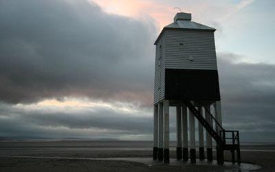 Lighthouse against a dark evening sky